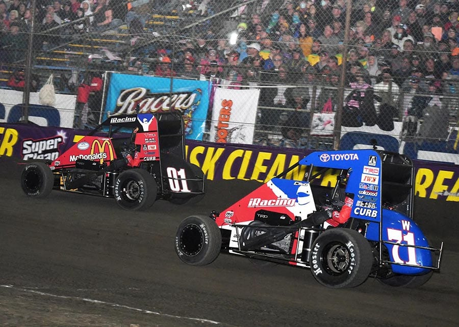 Kyle Larson (01) leads Christopher Bell during this year's Chili Bowl main event. (Frank Smith photo)