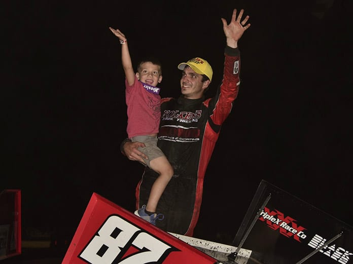 Aaron Reutzel celebrates his victory Saturday at the Dirt Oval at Route 66. (Mark Funderburk Photo)