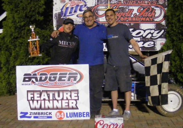 Davey Ray is joined by car owner Mark Ray, and chief mechanic Robbie Ray after winning Sunday Night's Zimbrick Chevrolet of Sun Prairie Badger Midget Racing Series feature at Angell Park Speedway.