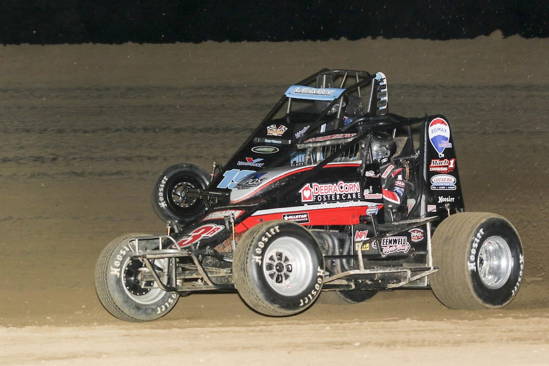 Kyle Cummins (3c) battles C.J. Leary Thursday night at Lincoln Park Speedway. (Dick Ayers photo)