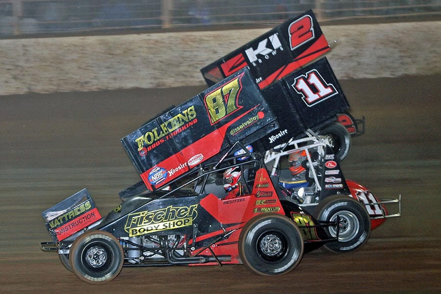Aaron Reutzel (87), Zeb Wise (11) and Kerry Madsen battle for position during Saturday's World of Outlaws NOS Energy Drink Sprint Car Series feature at The Dirt Track at Charlotte. (Jim Denhamer Photo)