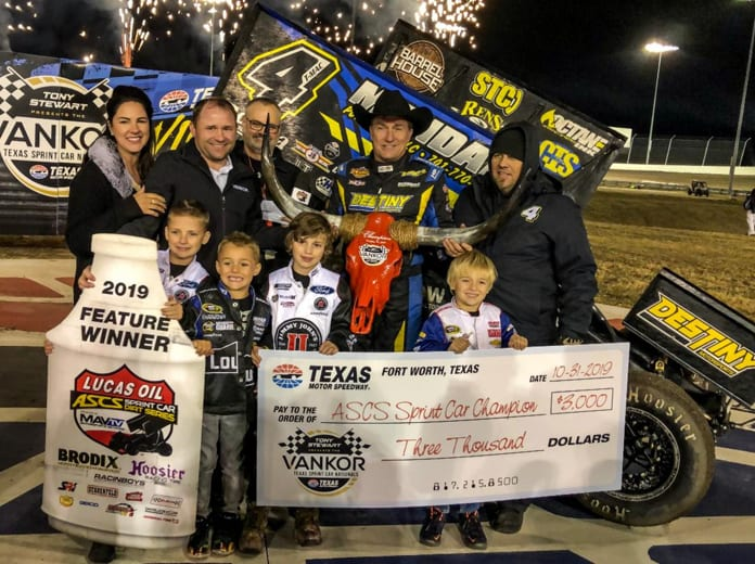 Terry McCarl poses in victory lane with his family and crew after winning night one of the Texas Sprint Car Nationals. (Gabe Flores Photo)