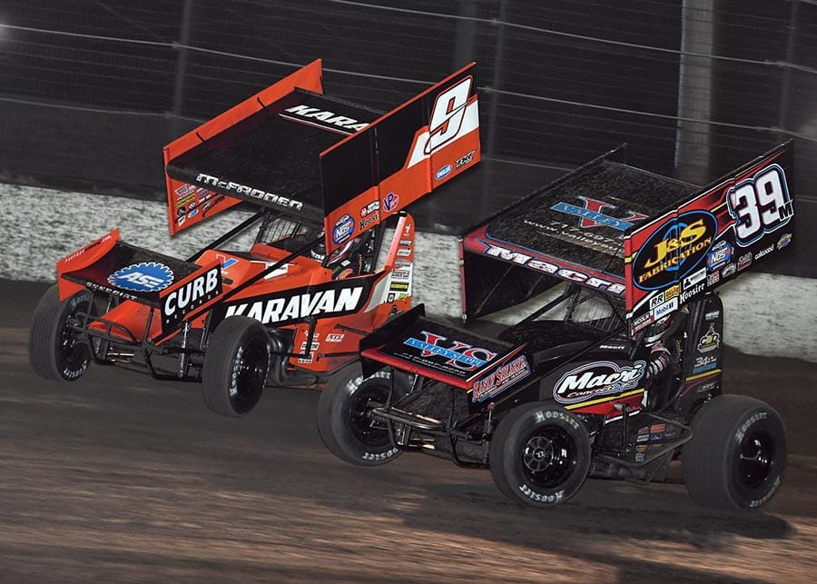 James McFadden (9) battles Anthony Macri at Volusia Speedway Park in 2020 during the DIRTcar Nationals. (Frank Smith photo)