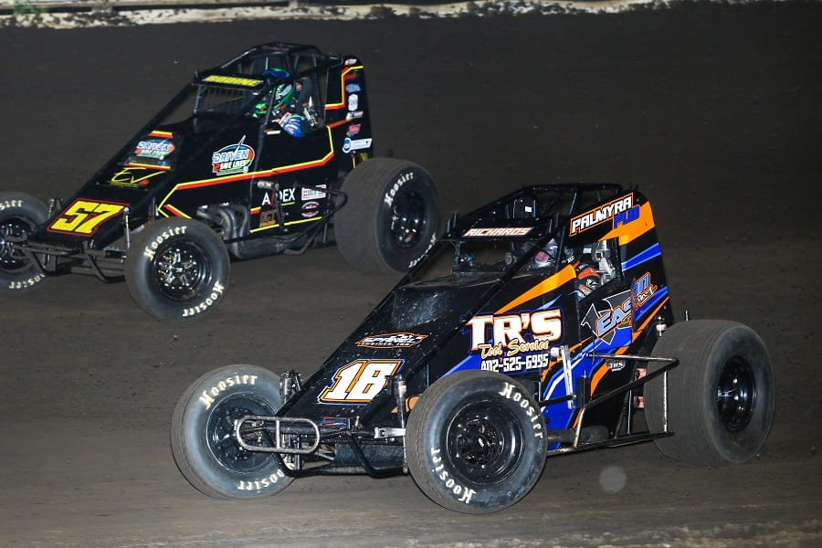 Cole Bodine (57) pressures Terry Richards during Friday night's POWRi WAR Sprint League event at Pepsi Lee County Speedway. (Brendon Bauman photo)