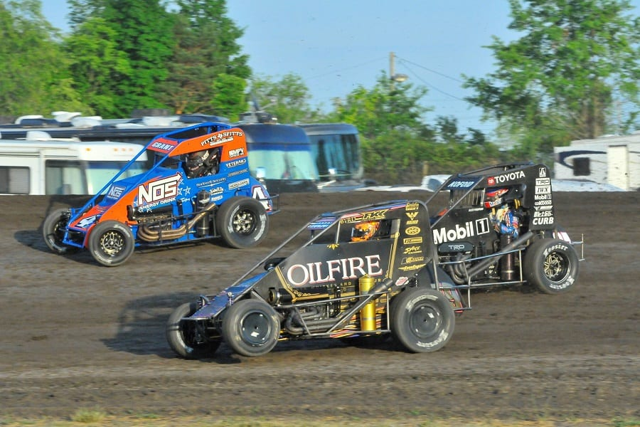 Tanner Thorson (19) duels with Buddy Kofoid (67) and Justin Grant during during Wednesday's Indiana Midget Week event at Gas City I-69 Speedway. (Randy Crist photo)