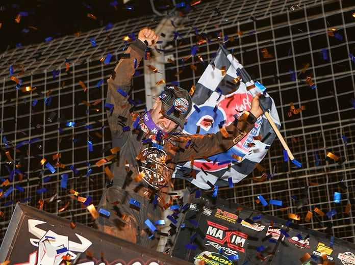 David Gravel celebrates in victory lane Friday at The Dirt Track at Charlotte. (Adam Fenwick Photo)