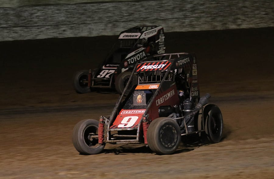 Daison Pursley (9) races under Brenham Crouch during the USAC NOS Energy Drink National Midget Series portion of Friday's Western World Championship preliminary event at Arizona Speedway. (Ivan Veldhuizen Photo)