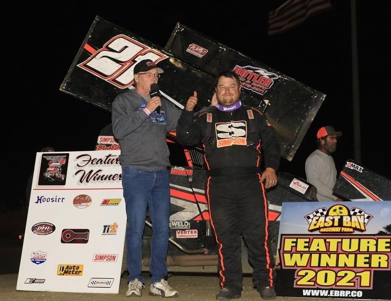 Justin Webster is interviewed in victory lane at East Bay Raceway Park. (Mike Horne photo)