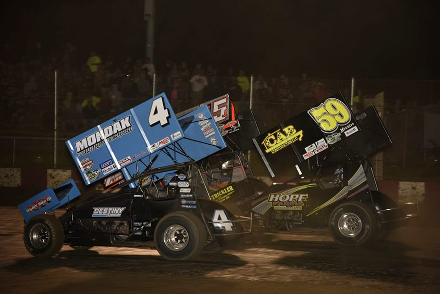 Parker Price-Miller (4), Jeremy Schultz (5J) and Sammy Swindell battle for position during Thursday's Arctic Cat All Star Circuit of Champions event at Angell Park Speedway. (Mark Funderburk Photo)