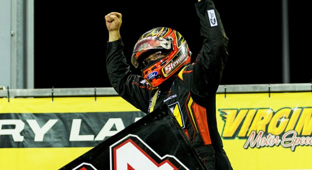 Tony Stewart celebrates his All Star Circuit of Champions triumph Thursday at Virginia Motor Speedway.