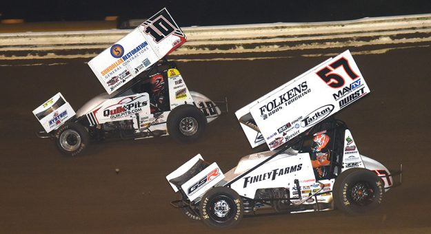 Kyle Larson (57) chases Zeb Wise Monday at Wayne County Speedway. (Paul Arch Photo)