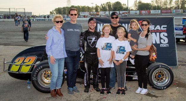 Robbie Rice (in black hat and shirt) celebrates with driver Logan Seavey and family after capturing the 2021 USAC Silver Crown Entrant Championship. (Rich Forman Photo)