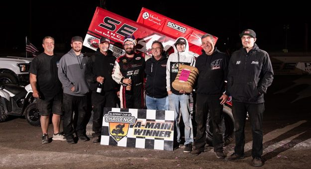 Dominic Scelzi in victory lane after his recent victory in the Cotton Classic. (Devin Mayo Photo)